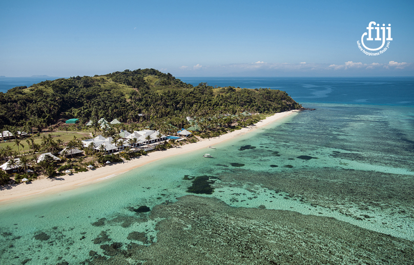 aerail view of fijian golden sand beach and clear blue green water
