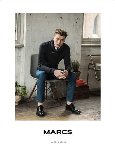 male model wearing marcs clothing sitting in chair