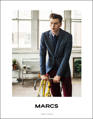 marcs male model holding onto drop handlebars of yellow bike