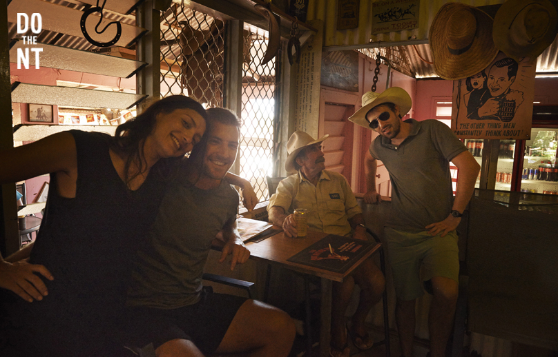 friends having a beer with a local inside a northern territory pub
