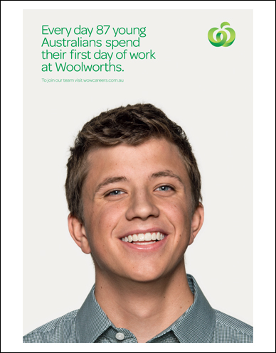 head shot of a smiling young australian on their first day of work at woolworths
